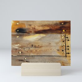 Wooden shipboard with nails and screws Mini Art Print