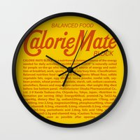 metal gear solid Wall Clocks featuring Metal Gear Solid - Calorie Mate Block by GunnerGrump