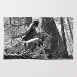 Knight riding through the forest Rug