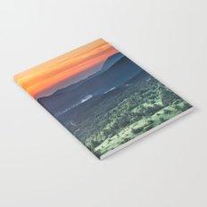 Beautiful sunset behind green fields Notebook