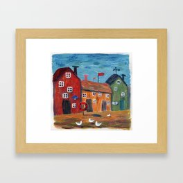 Wooden toy drift houses near the sea with gulls. Framed Art Print