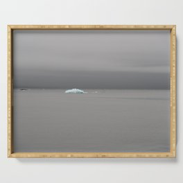 A lone blue iceberg from a glacier sits in Resurrection Bay in Alaska's Kenai Fjords National Park Serving Tray