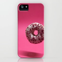 Macro shoot of hanging white donut over pink background iPhone Case