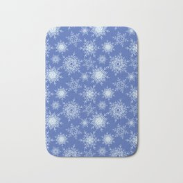 Christmas pattern with snowflakes on blue. Bath Mat