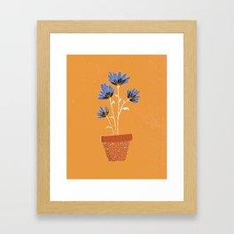 blue flowers on orange background Framed Art Print