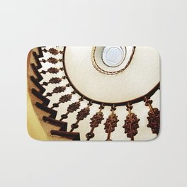 Spiral staircase in warm colours Bath Mat
