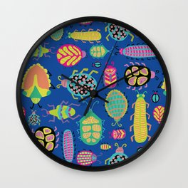 Tropical colorful bugs on a blue background pattern Wall Clock