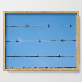 Contseptual shot of barbed wire over blue sky Serving Tray