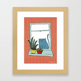 Cat by the window Framed Art Print