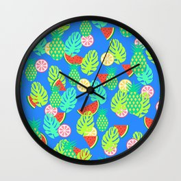 Watermelons and pineapples in blue Wall Clock