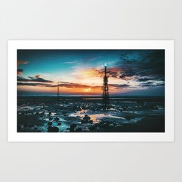 Beacons: Towers crowned by Flames on a Sunrise Beach Art Print