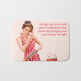 """Make Up Your Mind"" - The Playful Pinup - Baking Housewife Pinup by Maxwell H. Johnson Bath Mat"