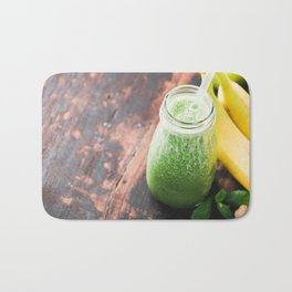 Close-up of green fresh smoothie with fruits, berries, oats and seeds, selective focus. Bath Mat