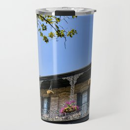 Traditional Brick House with a Black Wrought Iron Balcony and Pink Flowers in the French Quarter of New Orleans, Louisiana, USA Travel Mug