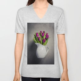 Levitating purple tulips against old concrete background Unisex V-Neck