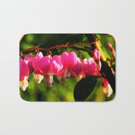 Pink Bleeding Hearts After an Evening Sun Shower Bath Mat