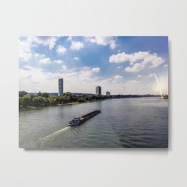 Freight boat through river against cityscape Metal Print