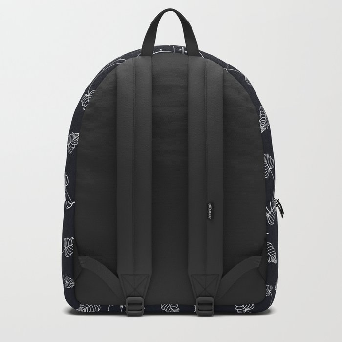 Delicate leaves on a black background . Backpack