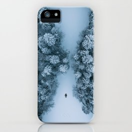 Man lying in the snow on a frozen lake in a winter forest - Landscape Photography iPhone Case