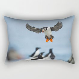 AN ATLANTIC PUFFIN COMING IN TO LAND WITH ITS WINGS SPREAD AND BIG ORANGE FEET DOWN WHILE A RAZORBILL SITS ON A ROCK BELOW ON MACHIAS SEAL ISLAND Rectangular Pillow