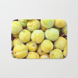 Yellow plums heap. Background shot. Bath Mat