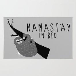 namast'ay in bed sloth Rug