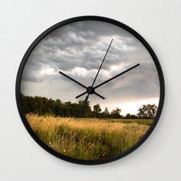 Stormy fields Wall Clock