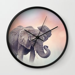 African Elephant walking in the grassland at sunset Wall Clock