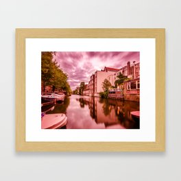 Canal houses and boats beside a canal in Amsterdam Framed Art Print