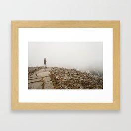 Person standing in fog on peak Framed Art Print