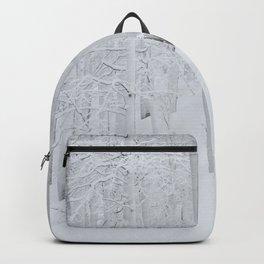 Snow covered forest winter wonderland Backpack