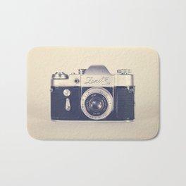Retro - Vintage Black Film Camera on Beige Background  Bath Mat