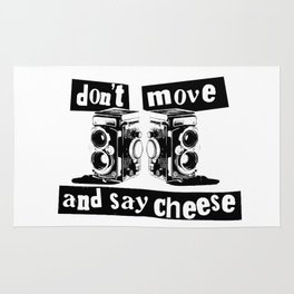 Quote - don't move and say cheese Rug