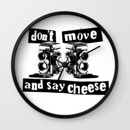Quote - don't move and say cheese Wall Clock