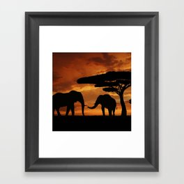 African elephants silhouettes in sunset Framed Art Print