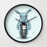 donnie darko Wall Clocks featuring Plushie Darko by Ludwig Van Bacon