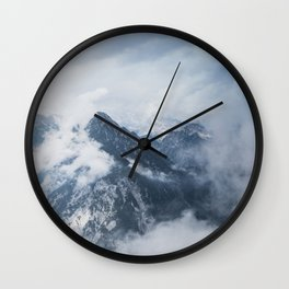 Misty mountain tops in the Alps Wall Clock