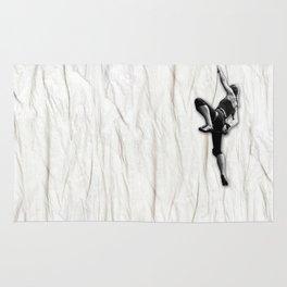 Woman Climbing a Wrinkle Rug