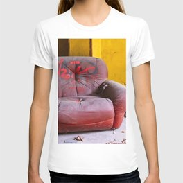 old red armchair abandoned in a disused warehouse T-shirt