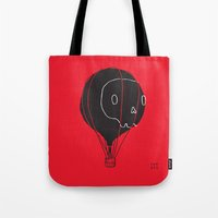 hot air balloon Tote Bags featuring Hot Air Balloon Skull by Fupete Art