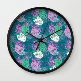 Firework textured floral on a blue/green base Wall Clock