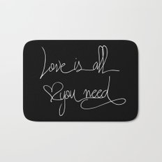 Love is all you need white hand lettering on black Bath Mat