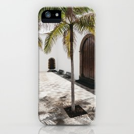 Palm tree growing in the street. La Palma, Canary Island. iPhone Case