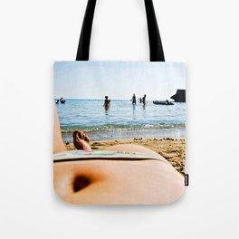 body in the sun Tote Bag