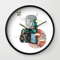 vintage camera Wall Clocks featuring Camera by dmirilen