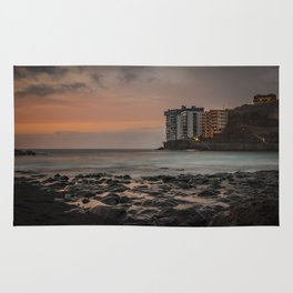 Sunset with long exposure on a beach of Tenerife. Rug