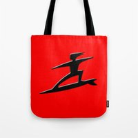 surfer Tote Bags featuring Surfer by gbcimages