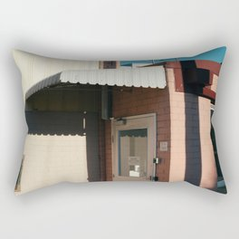 PINK AND BROWN CONCRETE BUILDING WITH WHITE AWNING UNDER BLUE SKY Rectangular Pillow
