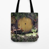 the hobbit Tote Bags featuring The Hobbit by Cynthia del Rio