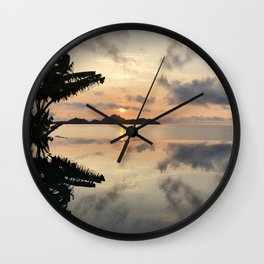 Sunset over Water Wall Clock
